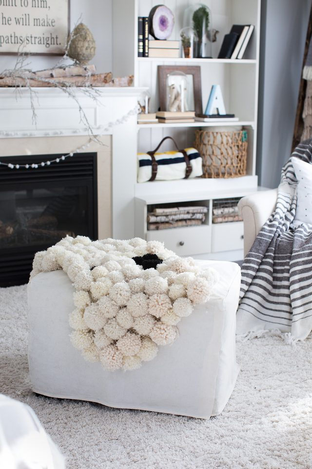 Picture Of diy chic pompom rugs to feel cozy in the winter  2