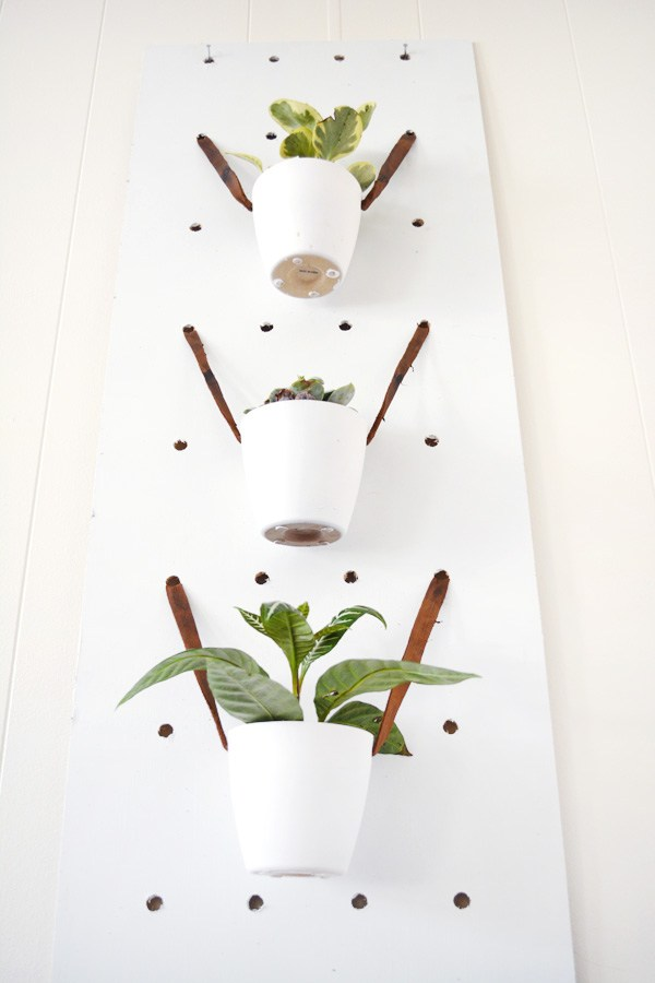 DIY pegboard planter hanger (via brepurposed)