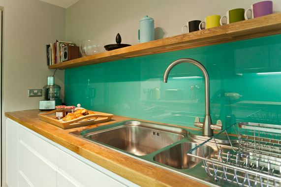 DIY turquoise glass backsplash (via addicted2decorating)