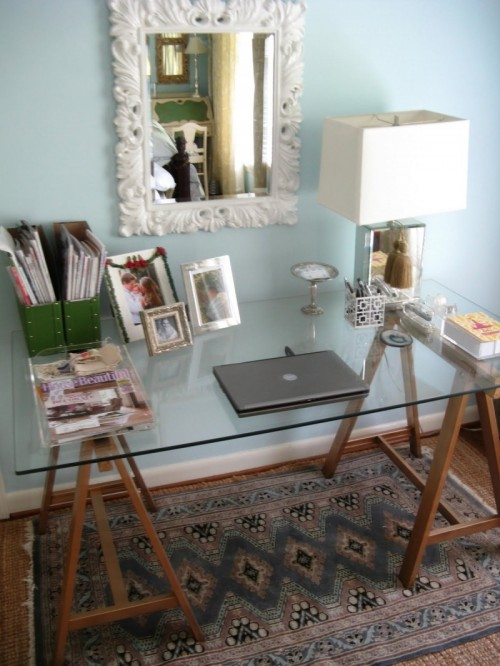 DIY sawhorse desk with a glass top (via shelterness)