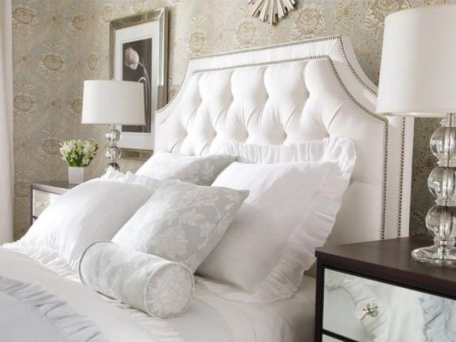 framed white nailed tufted headboard
