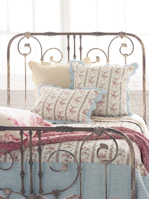rusty whitewashed metal headboard