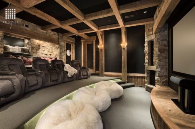 black basement ceiling with exposed wooden beams