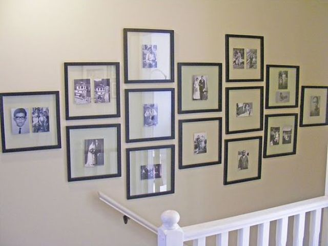 same size black frames as a minimalist stairs gallery wall