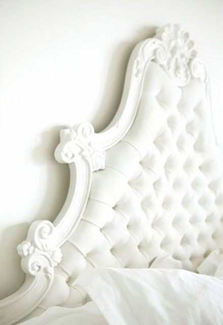 white curvy framed tufted headboard