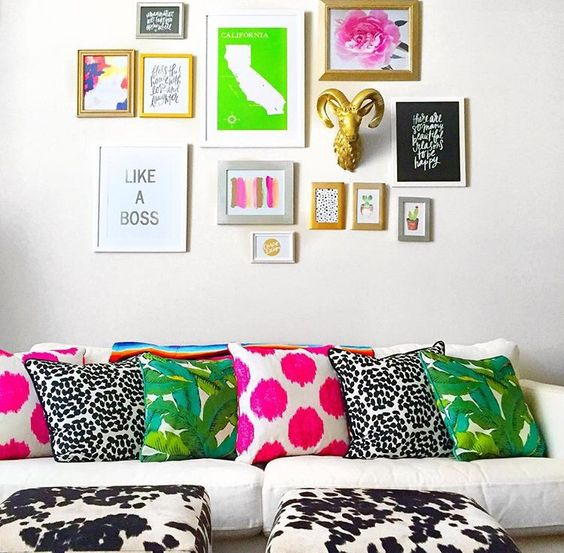 bold gallery wall with mismatching frames