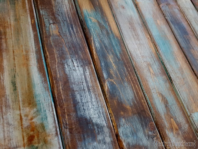 Mint, turquoise, white, and charcoal gray paints could help to make each faux barn wood board cool and unique. In the tutorial you'll also learn a dry-brushing technique. (via realitydaydream)