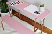 DIY pink and copper pipe desk