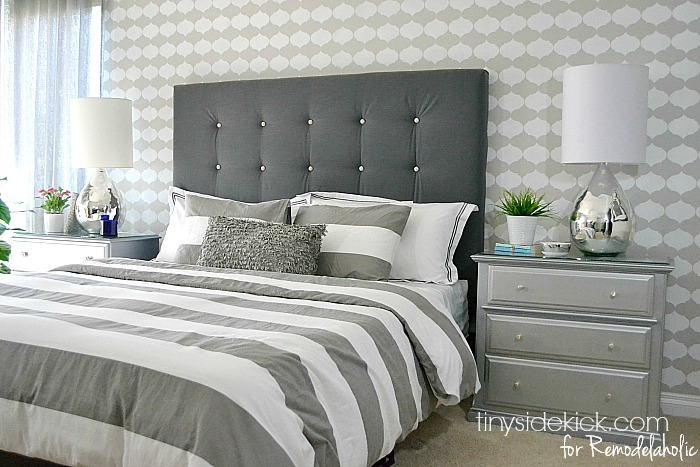 DIY tufted headboard with white buttons (via remodelaholic)