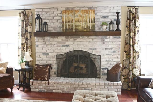 DIY whitewashed traditional brick fireplace (via theyellowcapecod)