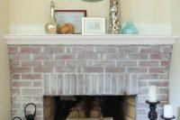 DIY brick whitewashed fireplace