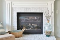 DIY whitewashed brick fireplace