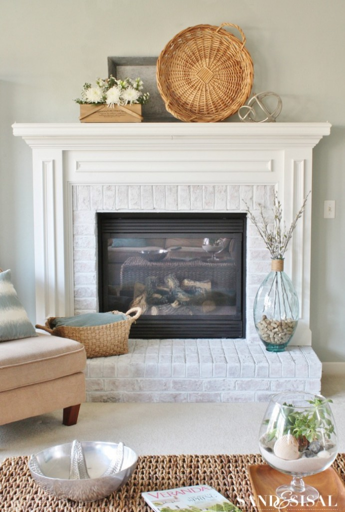 DIY whitewashed brick fireplace (via sandandsisal)