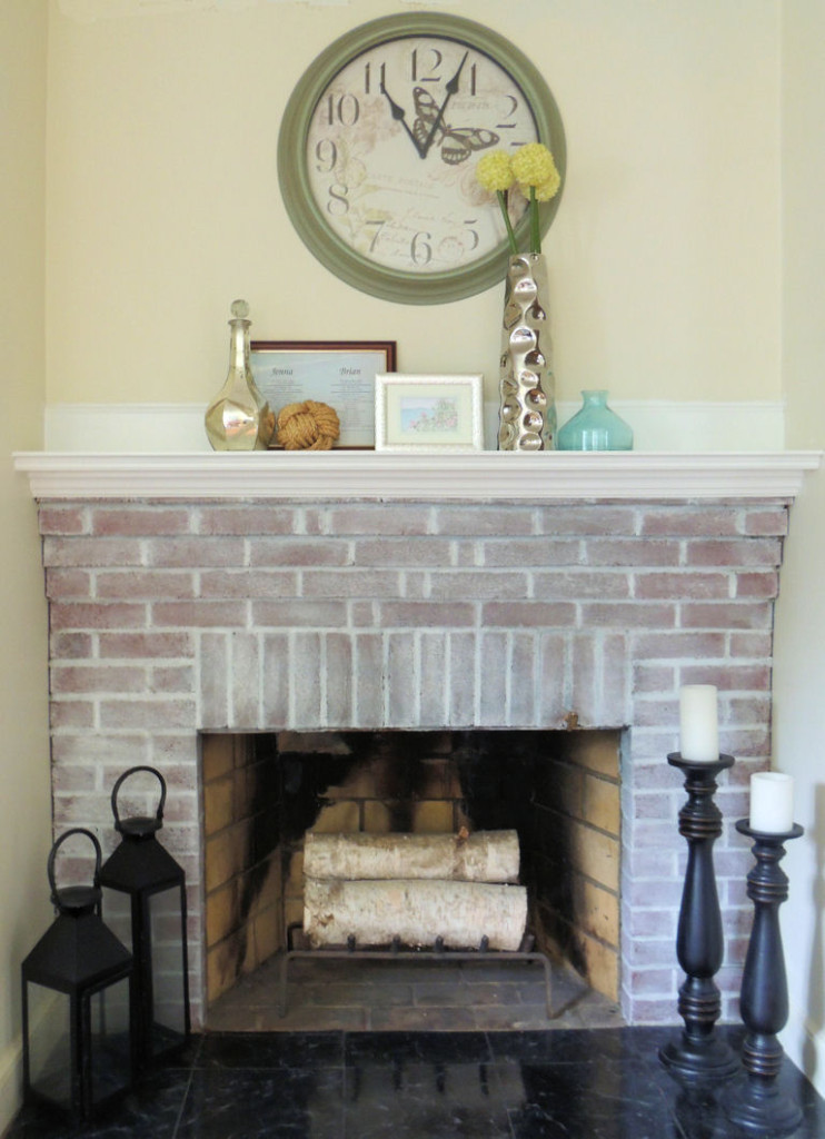 DIY brick whitewashed fireplace (via porch)