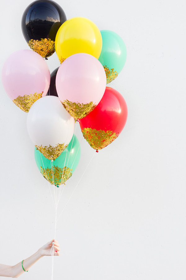 DIY confetti dipped balloons (via studiodiy)
