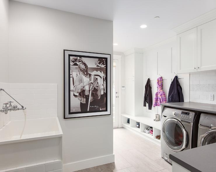 All White Laundry Room Combined With A Mudroom