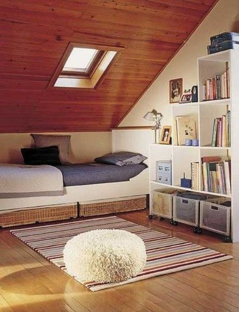 attic sleeping nook with a window