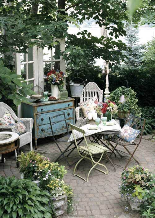Shabby Chic Courtyard With Wooden Furniture
