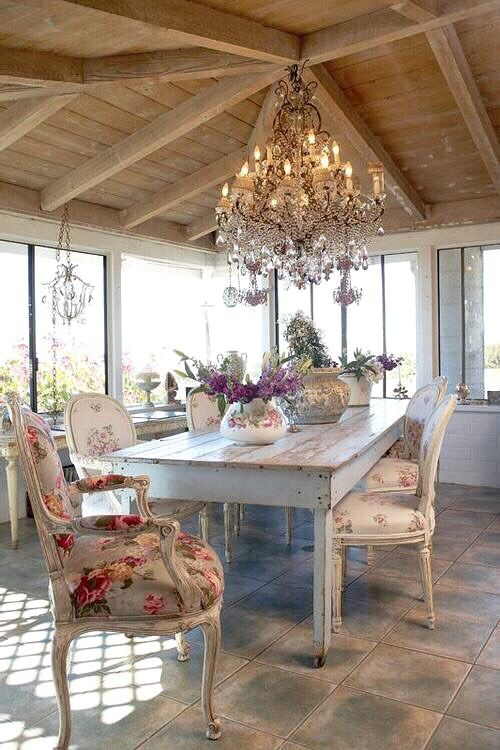 French-styled neutral dining area with floral patterns