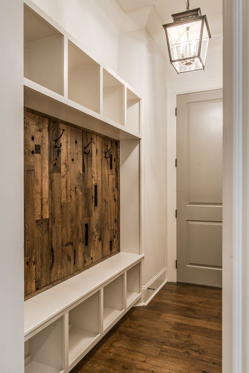 built-in mudroom compartments and bench