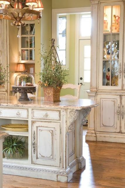 shabby chic whitewashed kitchen island and cabinets