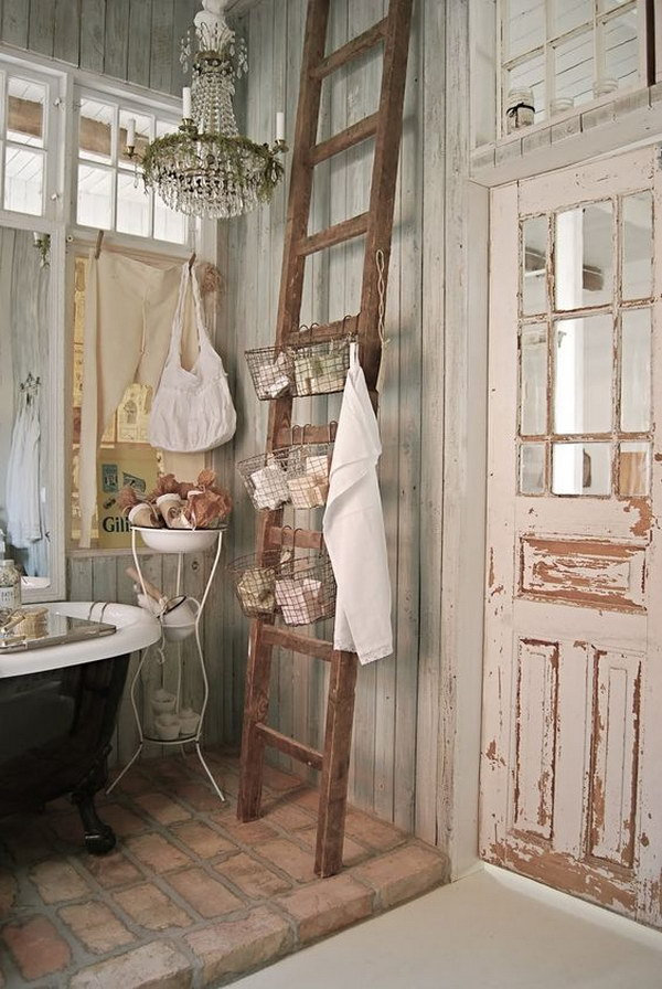 shabby chic bathrom with brick floors and a ladder as a shelf
