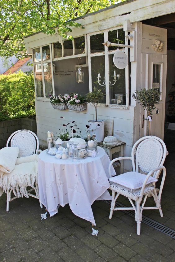 all-white shabby chic terrace with touches of rustic style