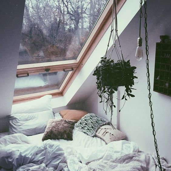 cozy sleeping nook with a window overhead