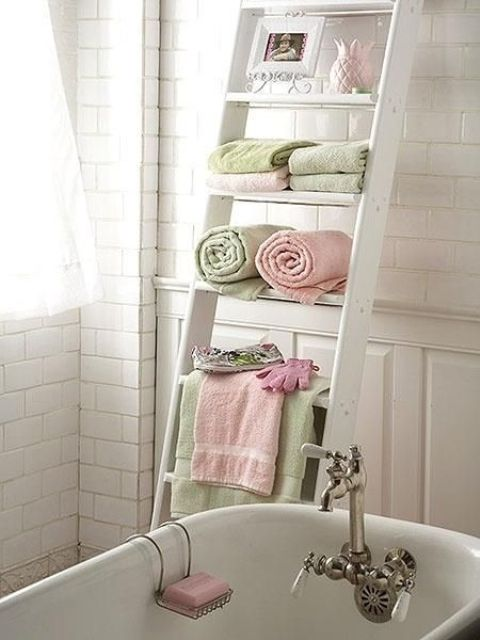 Ladders are an awesome way to save some space anywhere, including a bahtroom, take a distressed whitewashed one for a shabby chic bathroom