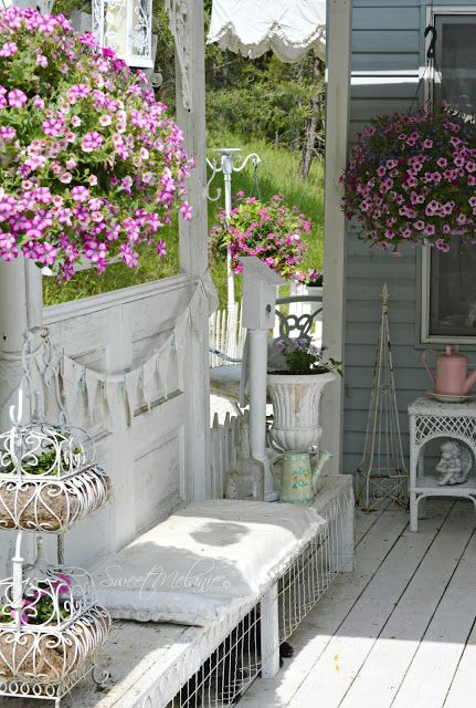 all-white shabby chic terrace with lots of flowers