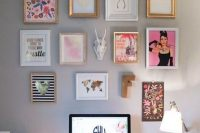 10 gallery art wall with posters, letters and an animal head