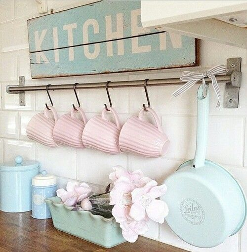 pastel tableware and a vintage sign