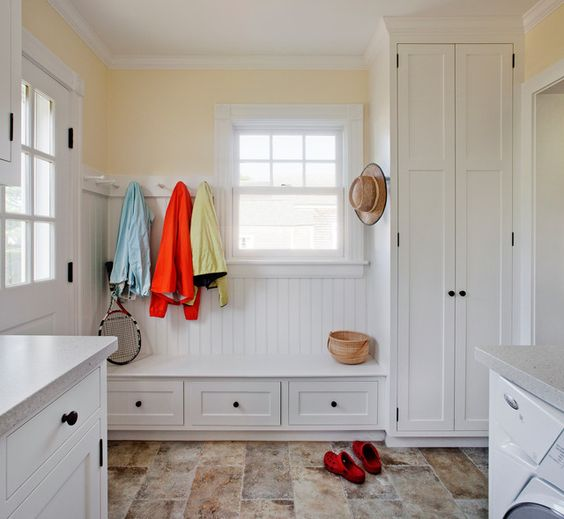 Airy Mudroom Laundry With Cabinetry