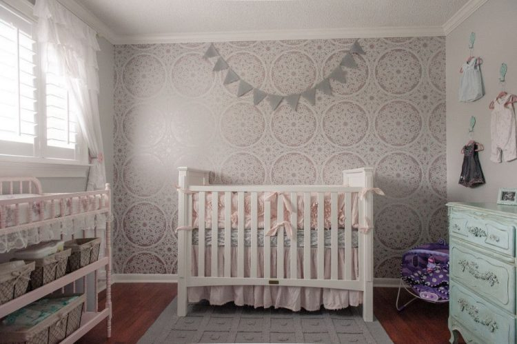 patterned wall behind the crib