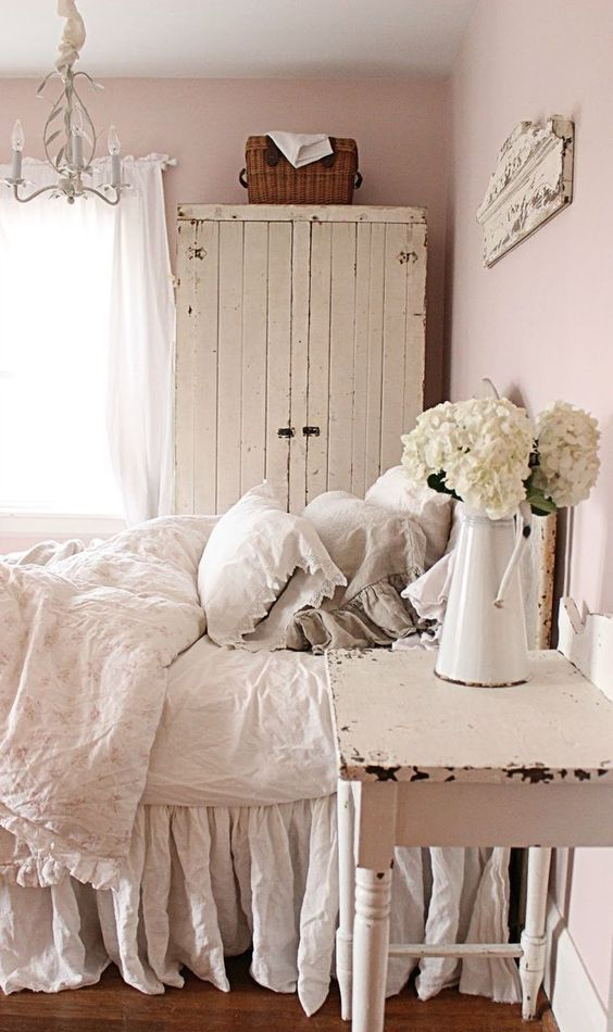 shabby chic bedroom with a whitewashed plank cabinet