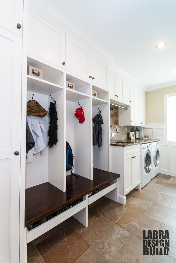 laundry and mudroom combo with cabinets