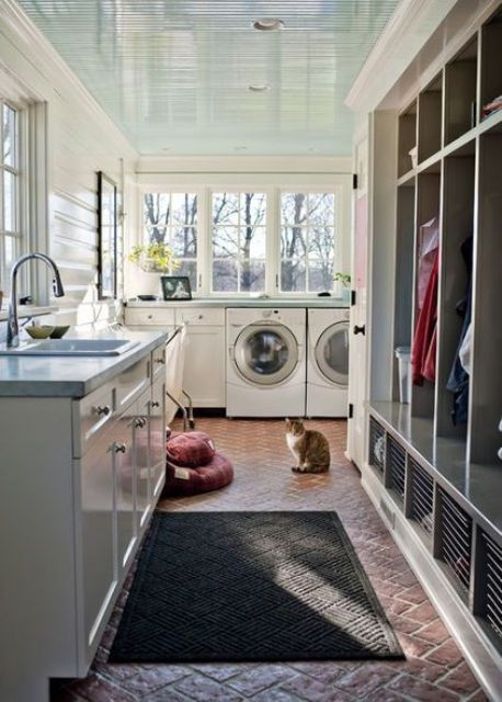 mudroom laundry with a sink area