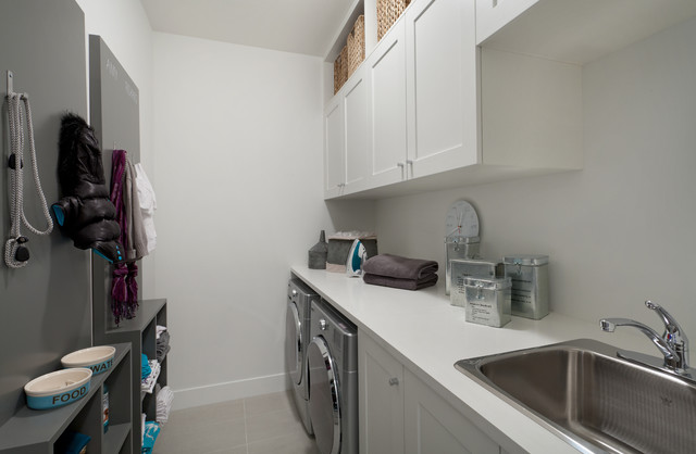 mudroom laundry with built-in cabinetry