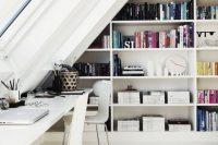 17 bookshelves in an attic home office