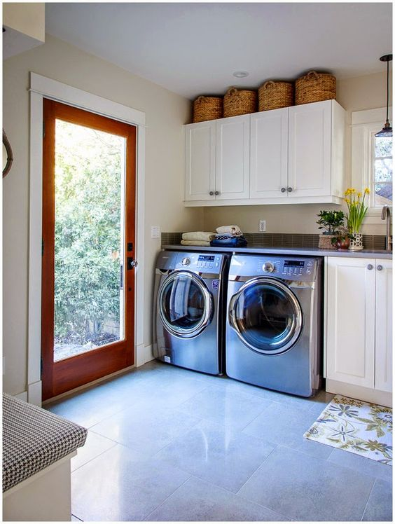 spacious mudroom laundry with cabinets