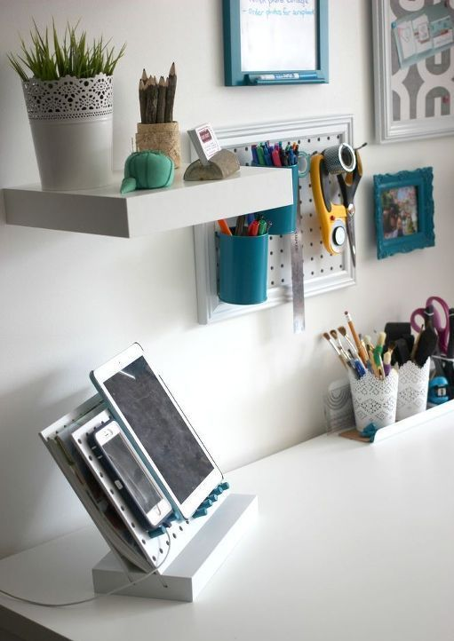 wall-mounted pegboards and frames for storing