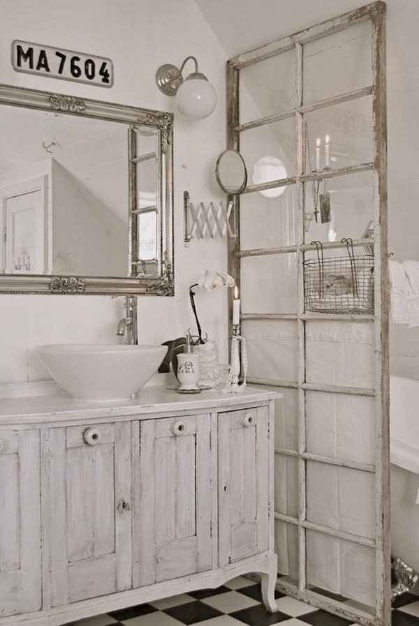 white shabby chic bathroom with an Old French door divider