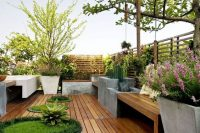 17 wooden deck with potted plants and lawn oasises