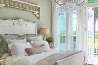 18 pastel-colored shabby chic bedroom with a crystal chandelier
