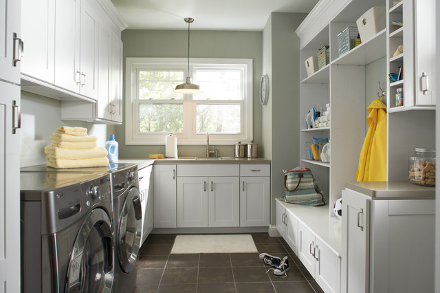 small mudroom laundry with white cabinetry