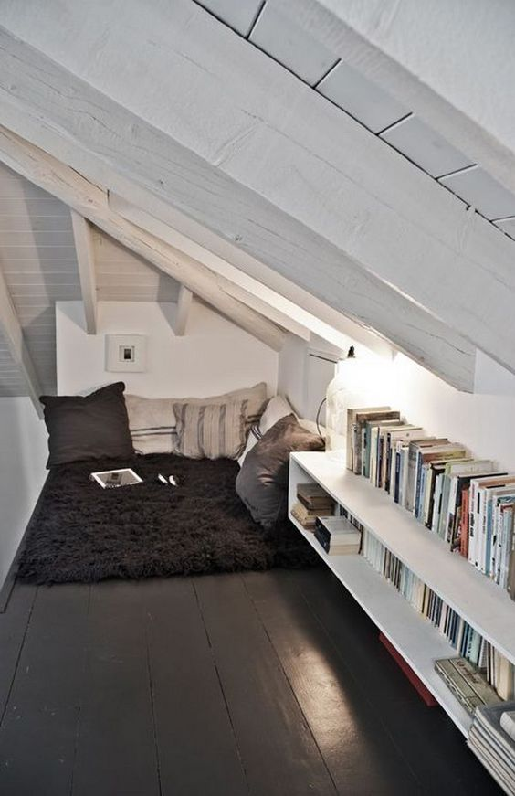 attic bookshelves fitted under the roof