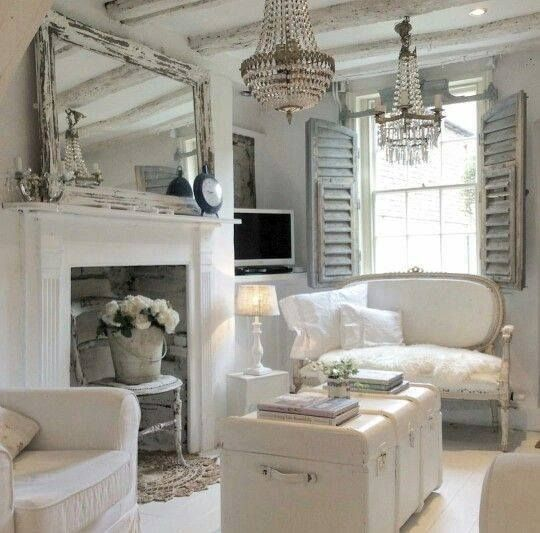 crystal chandeliers, shutters and a shabby frame mirror