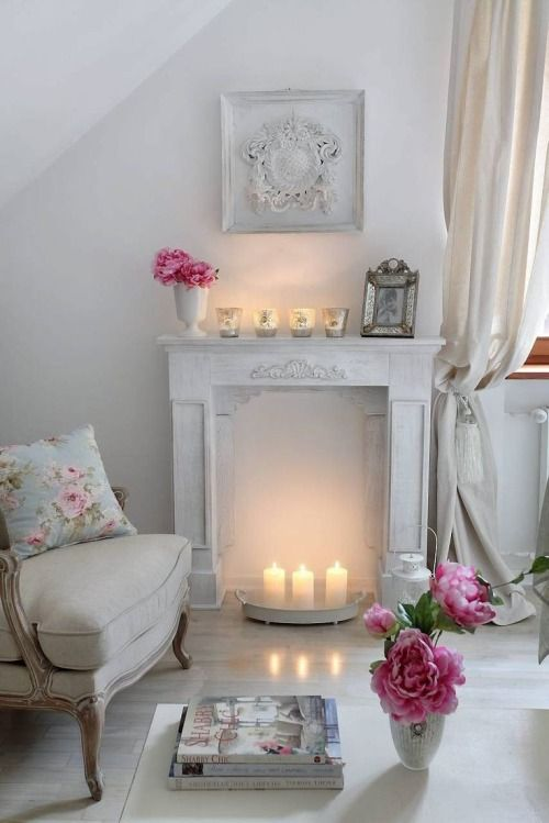 faux whitewashed fireplace with an art piece above