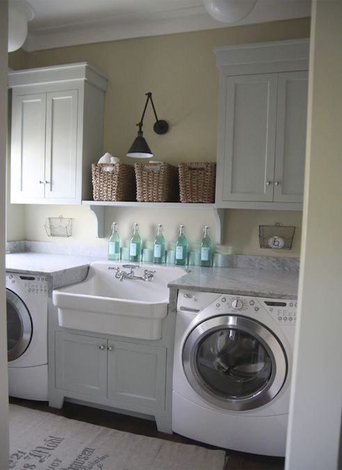 mudroom laundry with a sink