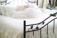 22 shabby chic bedroom with a black metal bed